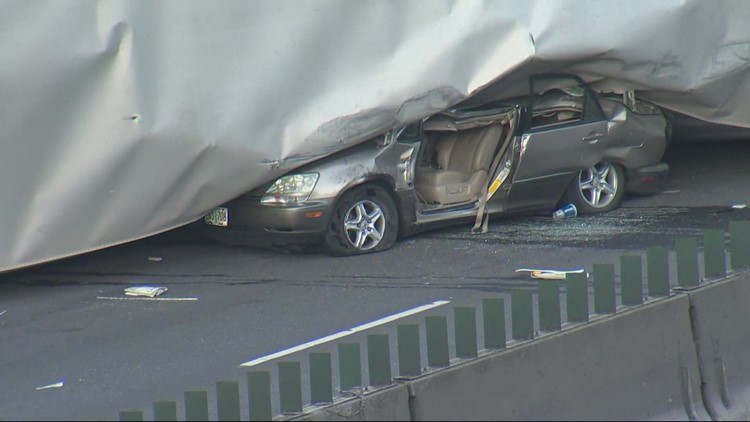 Semi crashes, tips onto car, closing NB lanes of I-5 at Terwilliger Blvd in Portland