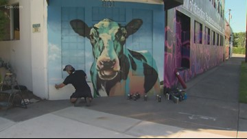 Graffiti murals cover old Sunshine Dairy building