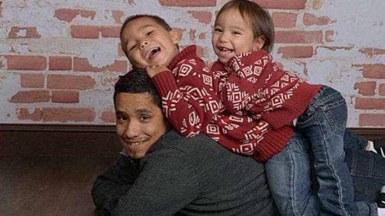 Lucio Fernandez with his kids