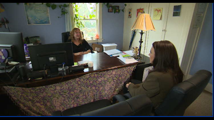 Cristin Severance sitting with small Portland business, victim of payroll scam