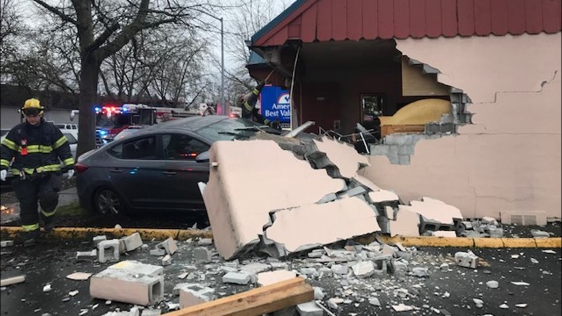 Guest avoids injury when car smashes into Oregon motel room