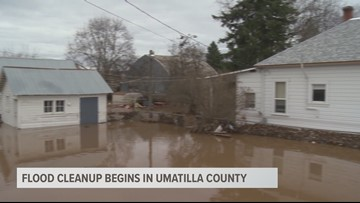 People pull together to help others after historic flooding