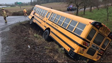 Minor injuries, driver cited after school bus crashes north of Molalla