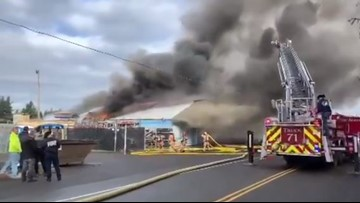 Crews put out fire that engulfed auto wrecking shop in Gresham