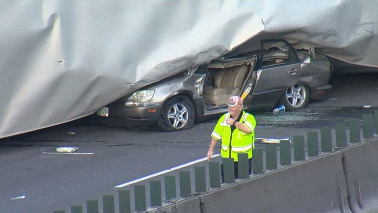 I-5 reopens after semi crashes, falls over onto car