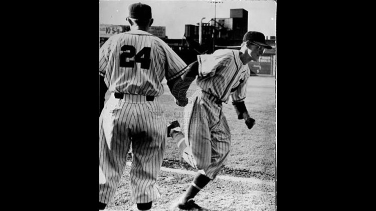 A Beavers player shakes hands while rounding third on his way to a home run, April 20, 1953