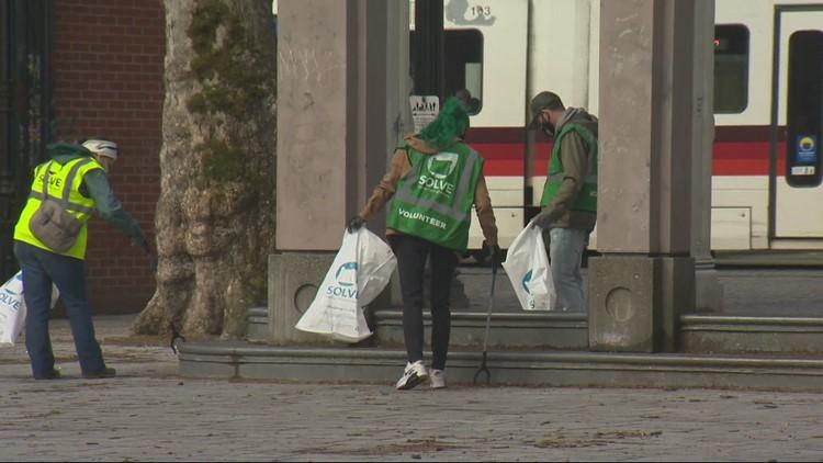 Volunteers clean up Portland's Old Town ahead of popular Saturday Market