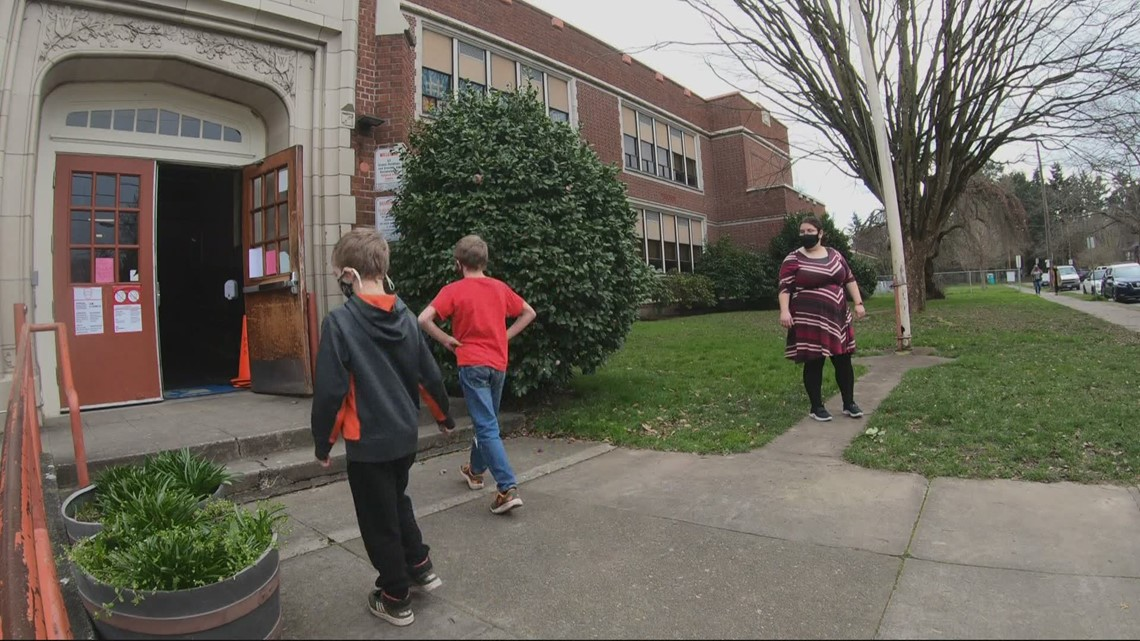 Some students back inside Woodlawn Elementary School for limited in-person learning