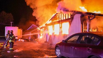 Woman dies, son badly burned in house fire in Boring