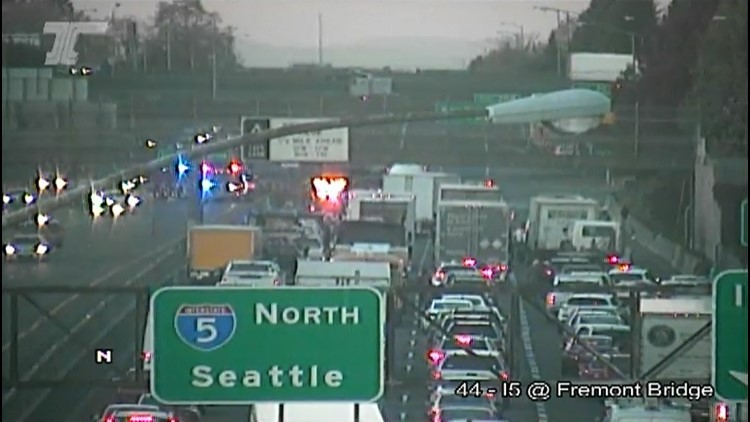 Traffic backup after northbound I-5 closed at Skidmore Street in Portland due to crash, fuel spill