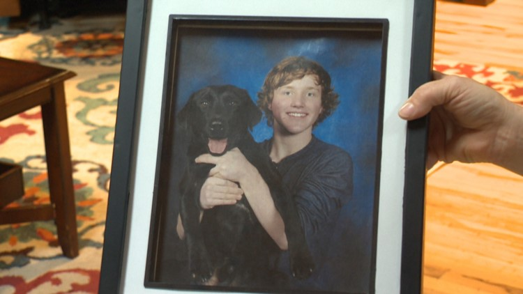 A picture of Carver and his dog Shadow