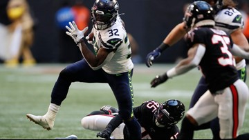 Wilson throws 2 touchdown passes as Seattle stops Atlanta 27-20
