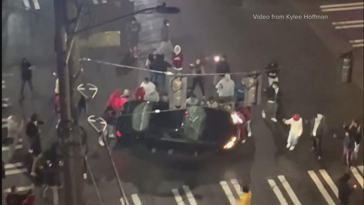 Group destroys car during street racing event in Seattle's University District