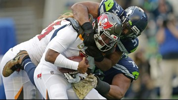 Russell Wilson throws 5 TDs, Seahawks outlast Bucs 40-34 in OT