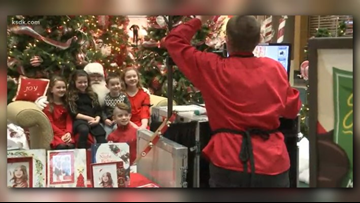 Families wait several hours to see the once 'lonely' Santa