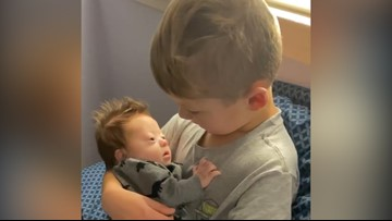 Watch: Boy sings to baby brother with Down syndrome
