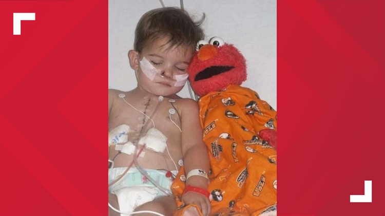 """Tucker and """"Melmo"""" during on of his surgeries in the hospital"""
