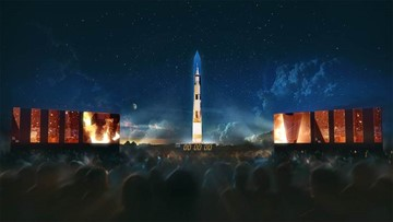 Saturn V rocket that sent Apollo 11 into space is projected onto the Washington Monument