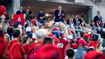 Cheers, chants of 'lock him up' greet President Trump at World Series