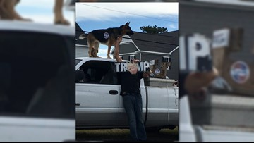 Voter intimidation? Picture shows Trump supporter with German Shepherd outside precinct